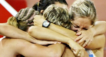 Members of Poland's relay team hug after their women's 4 x 100m relay heat at the Beijing 2008 Olympic Games